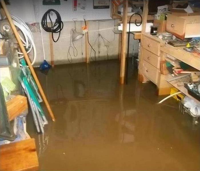 Standing water in garage; possessions becoming water damaged