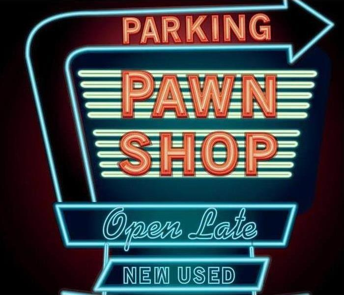 A blue and black open pawn shop sign.